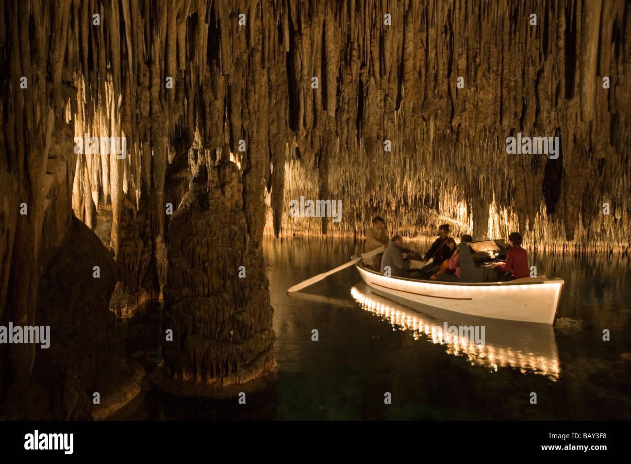 Classical Musicians On Boat Inside Cuevas Del Drach Cave Cavern Of The Dragon Porto Cristo Mallorca Balearic Islands Spain