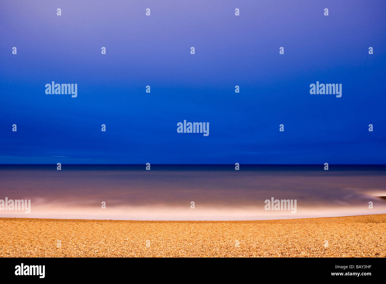 Beach in evening light, Brighton, East Sussex, England, Europe - Stock Image