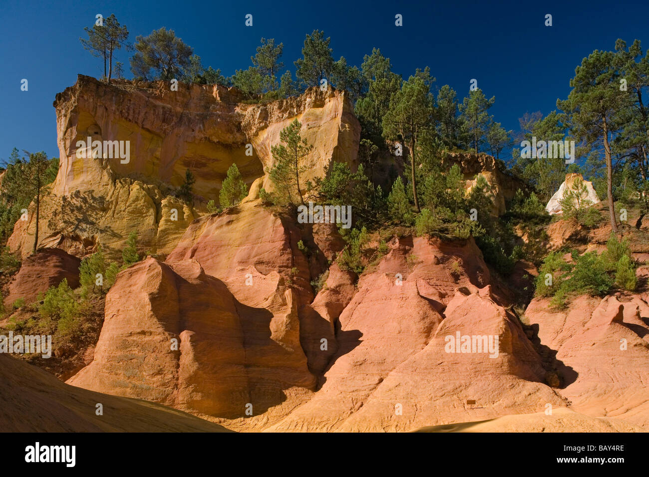 Ochre quarry in the sunlight, Roussillon, Vaucluse, Provence, France - Stock Image