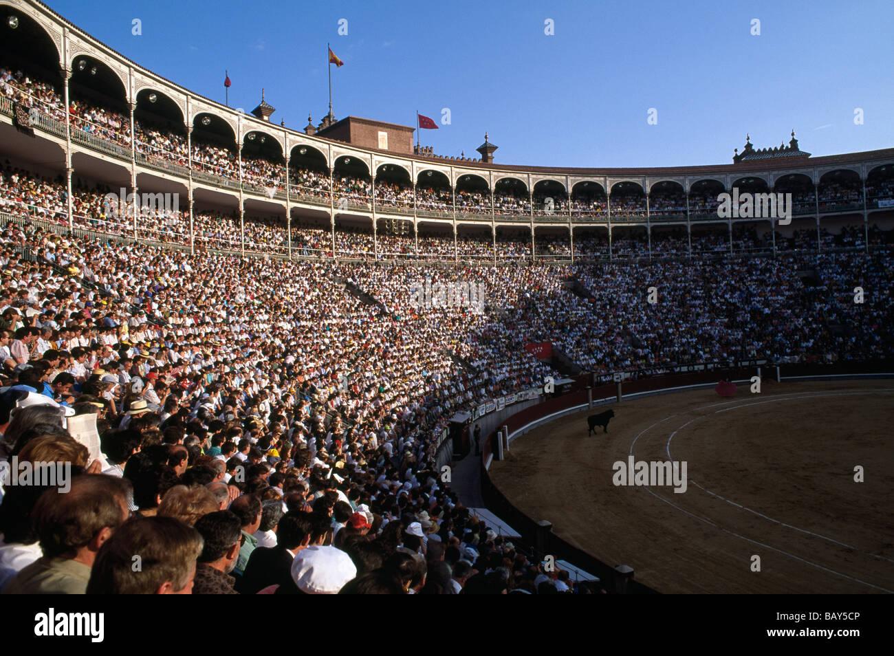 Fully occupied bullfighting arena, Fiesta de San Isidro, Madrid, Spain - Stock Image