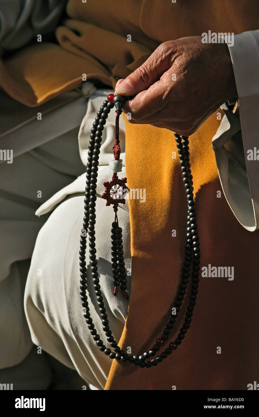 Monk with prayer beads, Buddhist rosary, Pusa Ding Temple, Mount Wutai, Wutai Shan, Buddhist centre, near the town - Stock Image