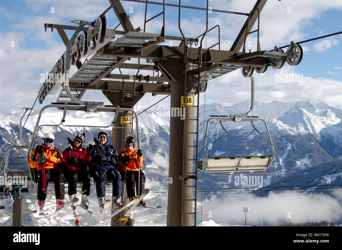 A group of skiers sitting on a chair lift, Bad Gastein, Austria - Stock Image