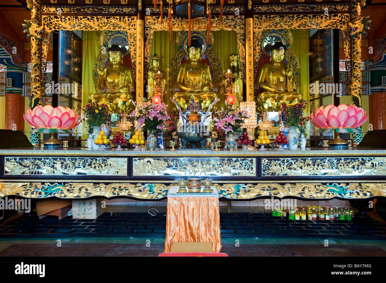 Gilded Buddha's on the Main Altar inside the Hall of the Great Hero at Po Lin Monastery. Lantau Island, Hong - Stock Image