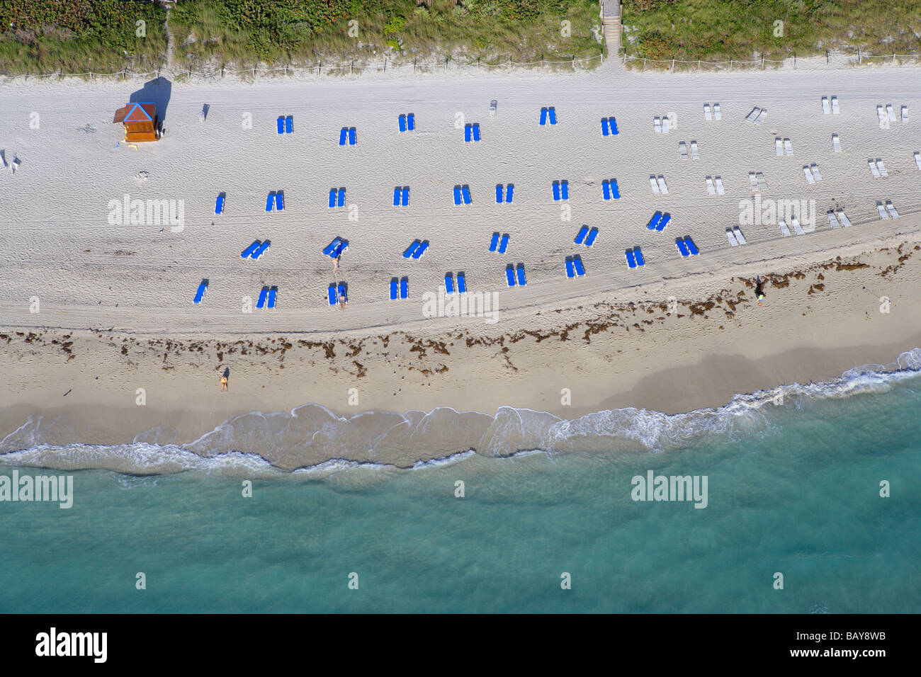Sandy beach with sun loungers, Miami Beach, Boardwalk district, Florida, United States of America, USA - Stock Image