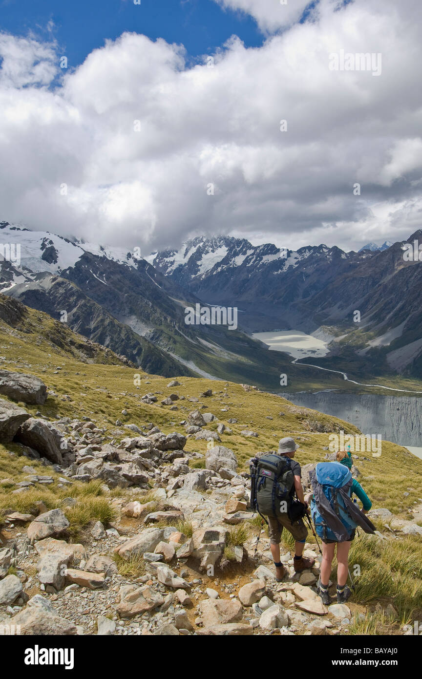 Hikers on trail to Mueller Hut Mt Cook Aoraki National Park South Island New Zealand - Stock Image