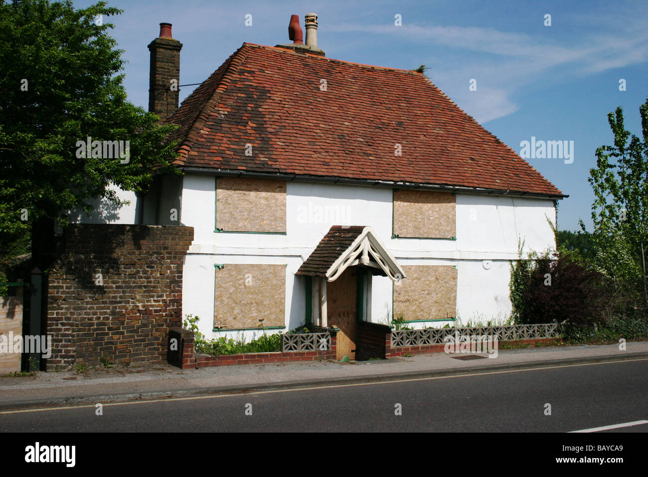Boarded up and unoccupied house Rainham Kent UK - Stock Image