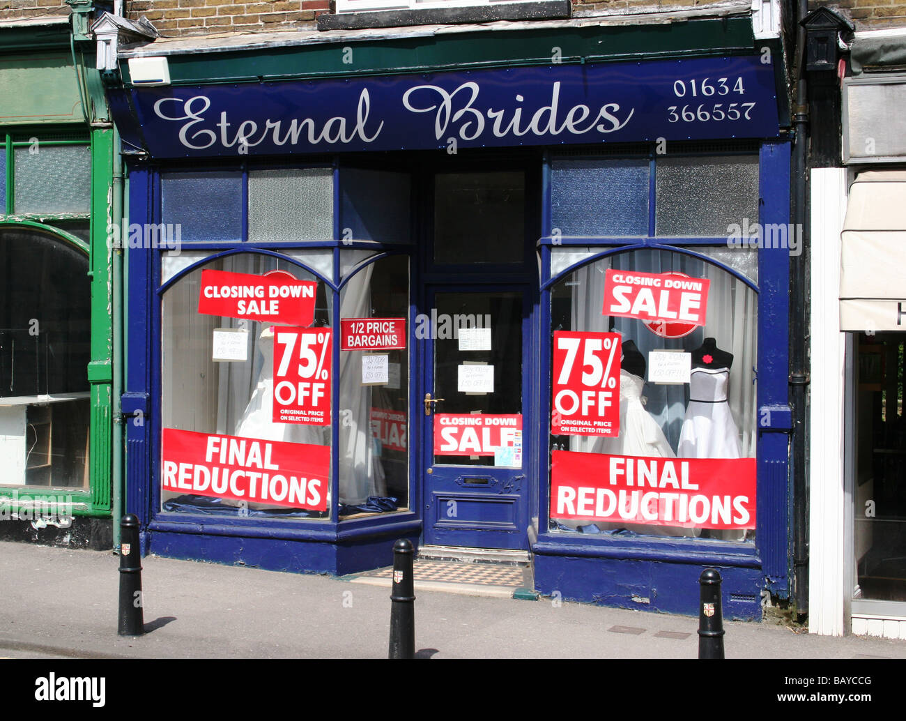 Bridal shop 75% off closing down sale. Shop closures and closing-down signs with final reductions. Stock Photo