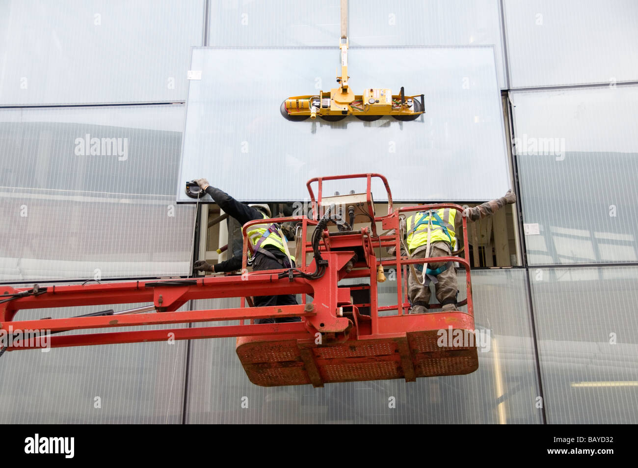 London Hackney May 2009 Installing large windows in new council building Stock Photo