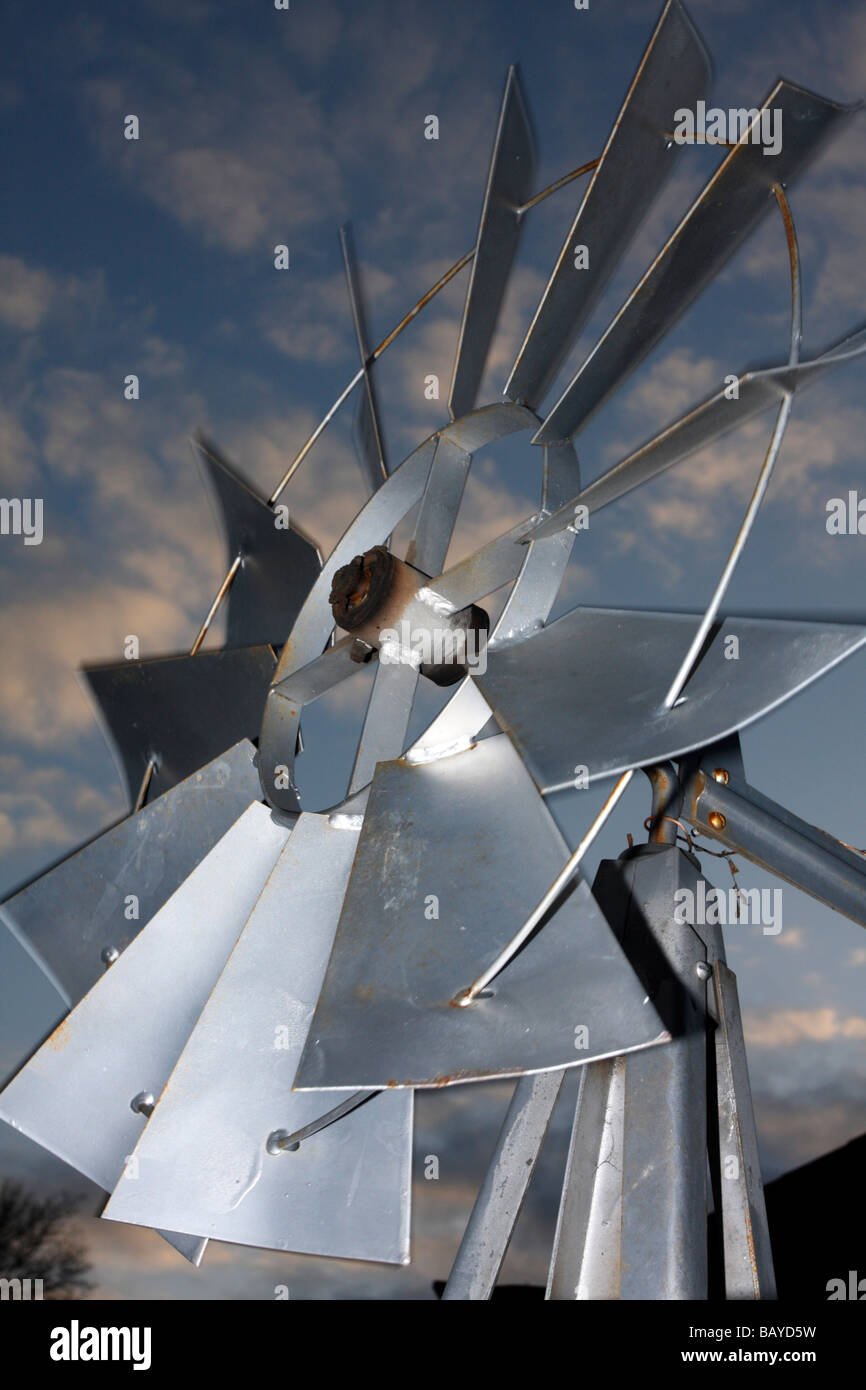 Windmill against sunset sky - Stock Image