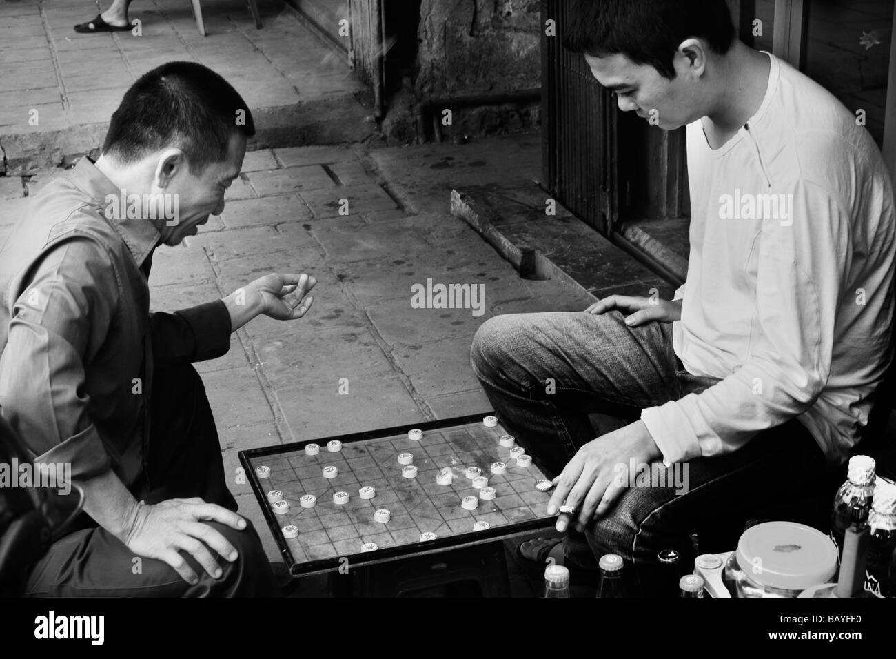Two men play xiangqi on the streets of the Old Quarter, Hanoi, Socialist Republic of Vietnam. Stock Photo