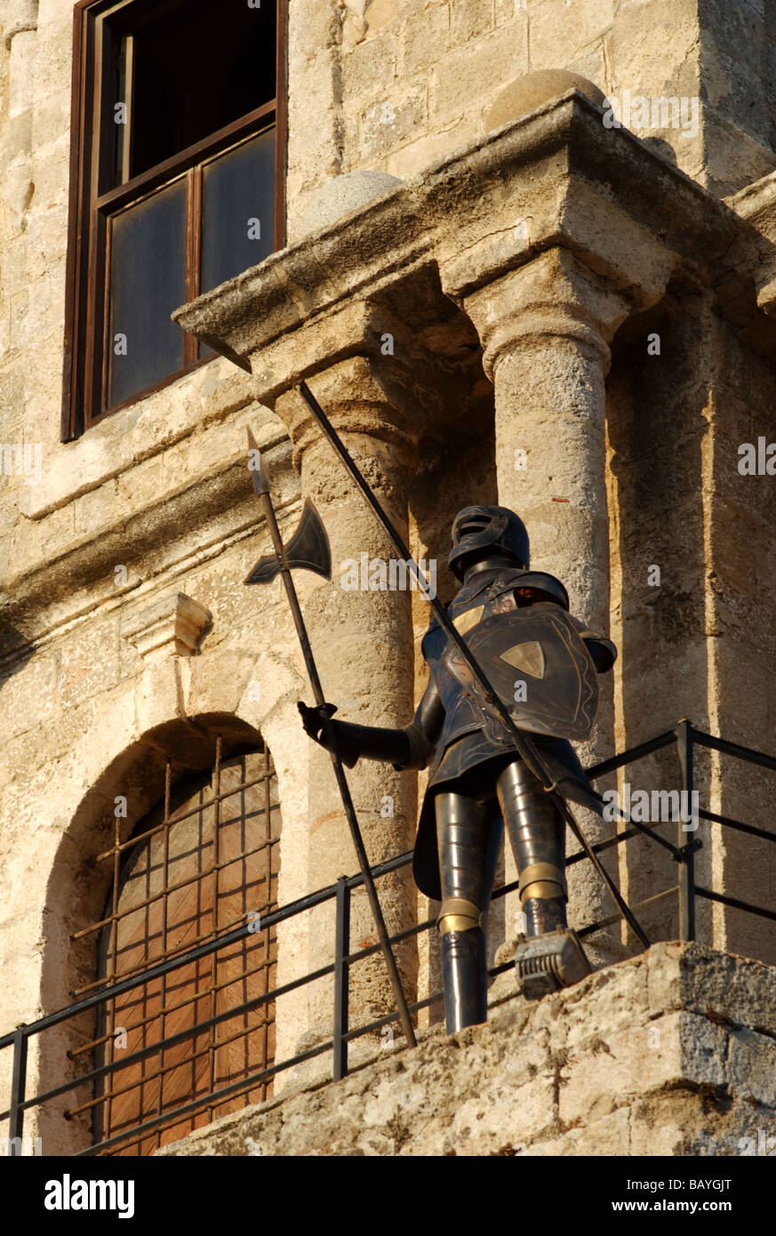 An empty suit of armor stands guard on the clock tower of the Palace of the Grandmasters, Rhodes, Greece - Stock Image