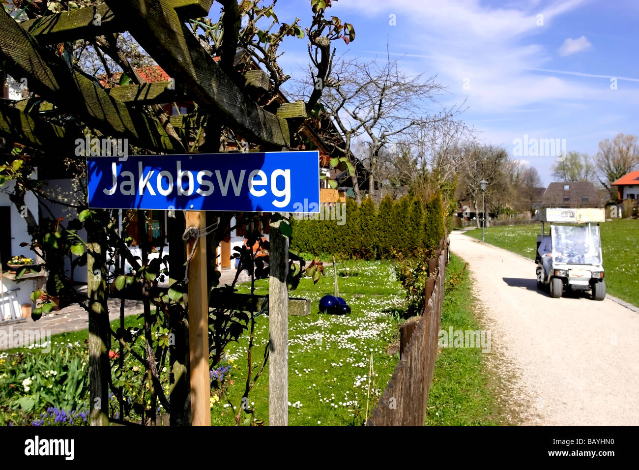 Jacobsweg Street Sign and Electric Goods Delivery Vehicle Fraueninsel Chiemsee Chiemgau Bavaria Germany, Europe Stock Photo