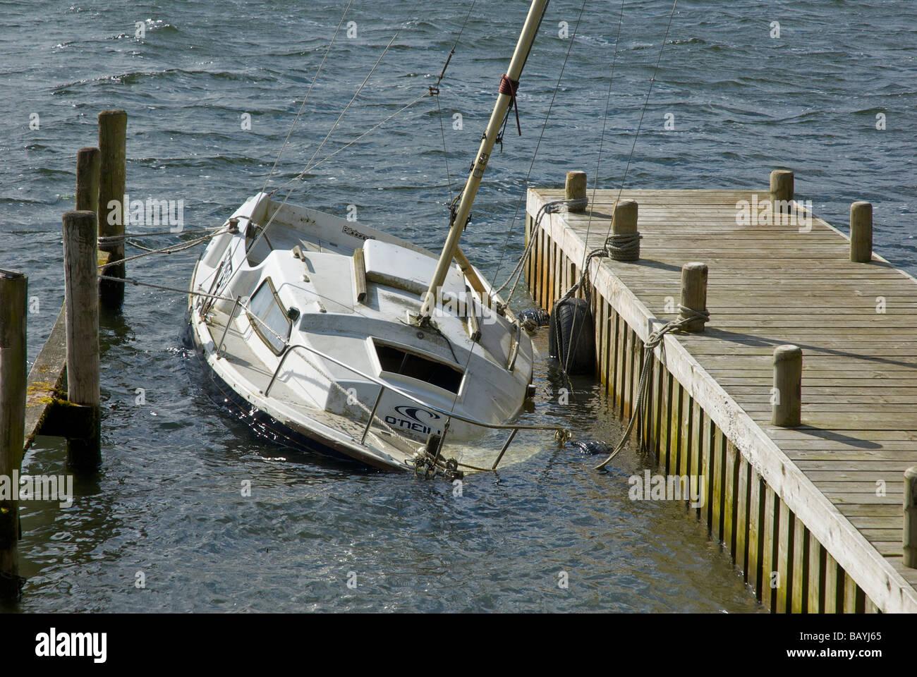 Sailing boat sunk, Lake Windermere, Lake District National Park, Cumbria, England UK - Stock Image