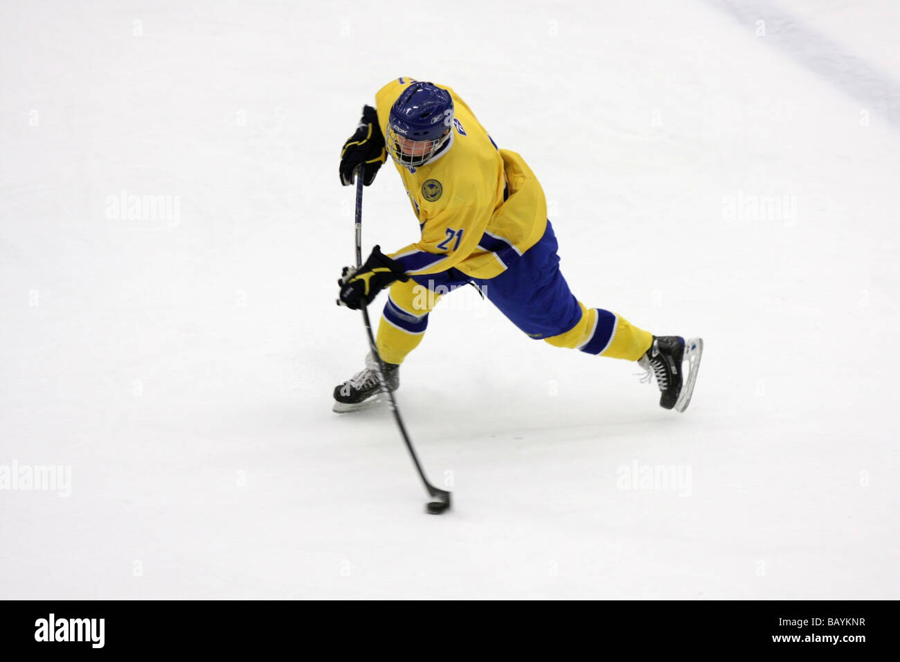 Swedish player no 21 Hampus Gstafsson firing away a shot. In this photo you can see how a composite stick is bent - Stock Image