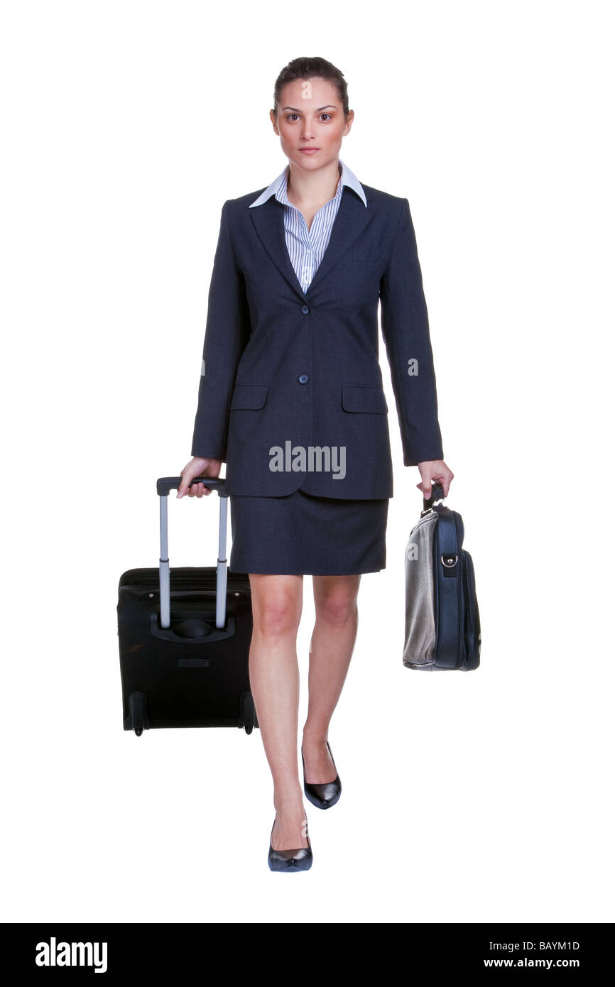 Businesswoman in suit with suitcase and briefcase isolated on white background - Stock Image