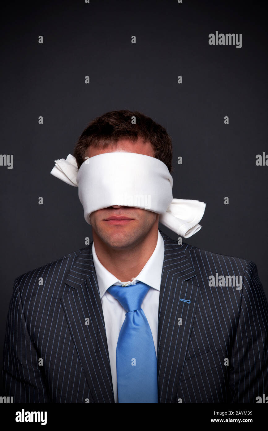 034af143536 Businessman wearing a blindfold on a dark background with copy space -  Stock Image