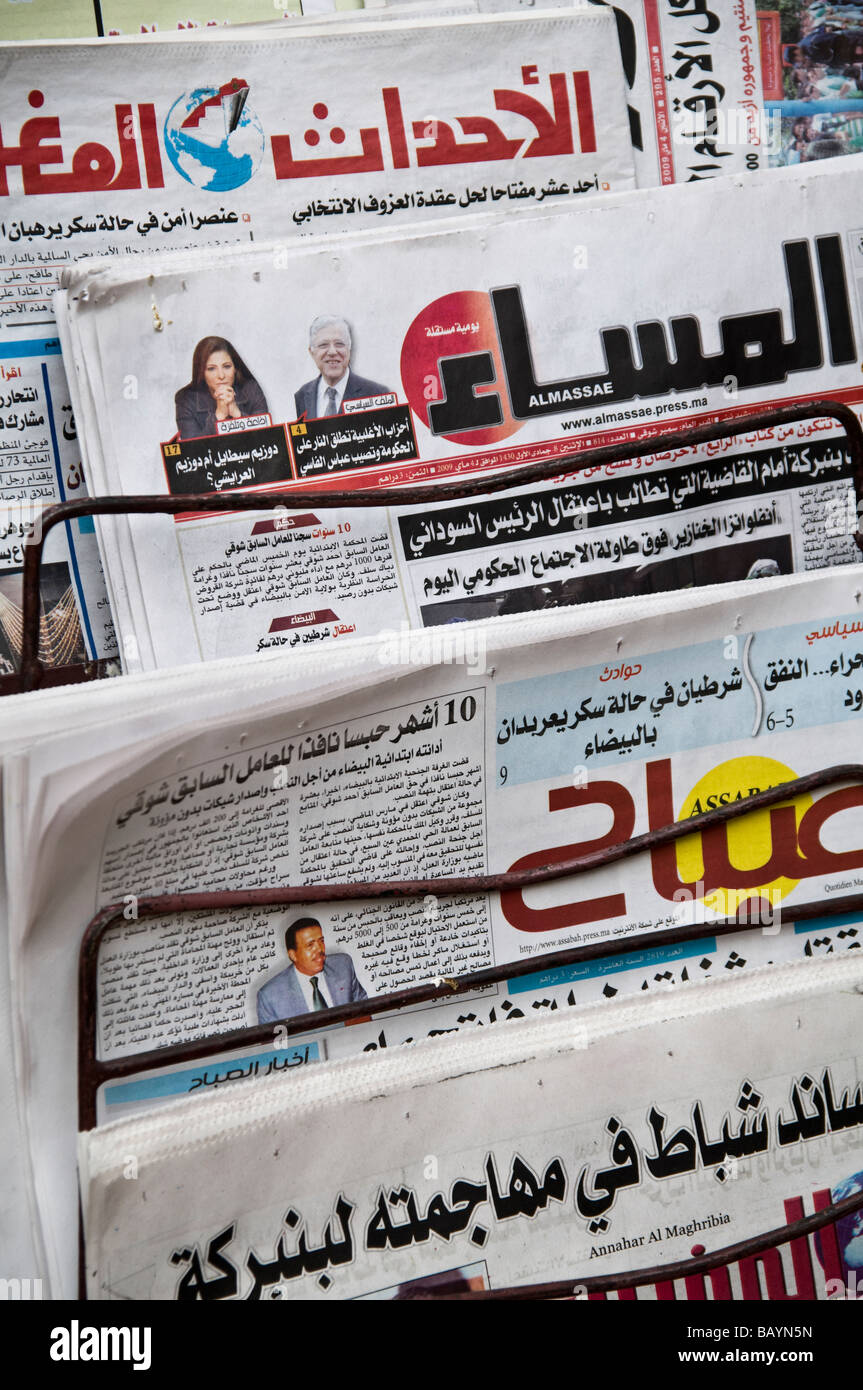 Rack of Arabic Moroccan newspapers, for sale in the Medina at Fes. Including Almassae and Annahar Al Maghribia. - Stock Image