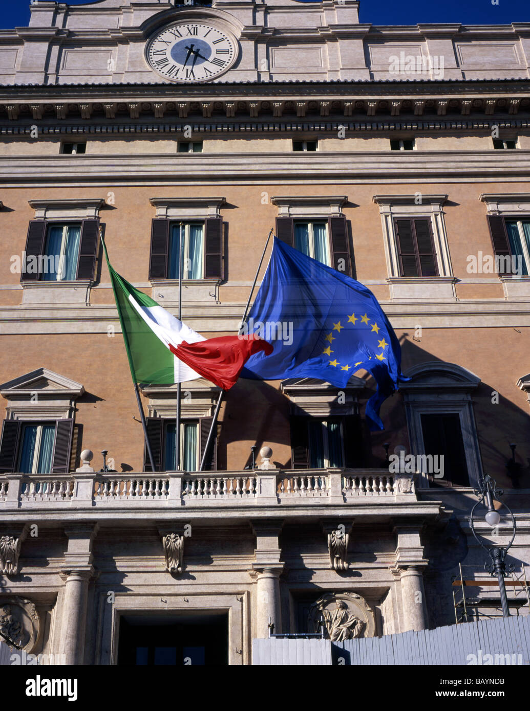 Italian and European Union Flags flying above the rear entrance to The Italian Parliament, The Palazzo di Montecitorio, Stock Photo