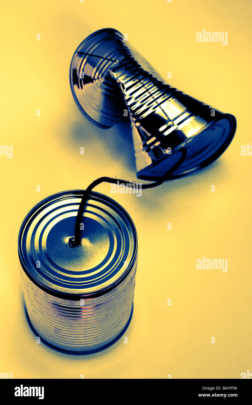 Two tin cans linked broken communication concept - Stock Image