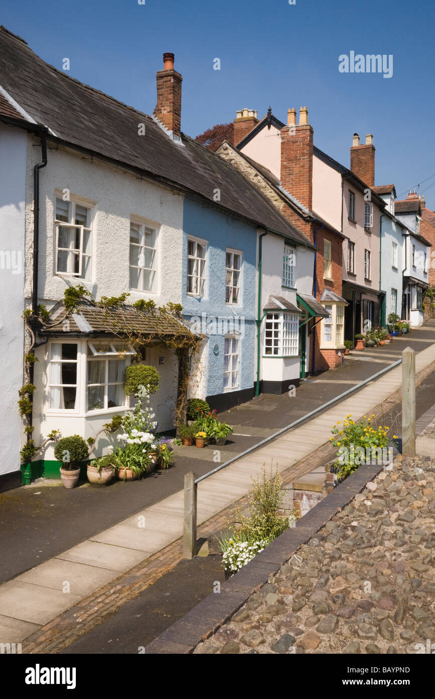 Row of colourful old terraced cottages in a residential street in Ludlow Shropshire West Midlands England UK Britain - Stock Image