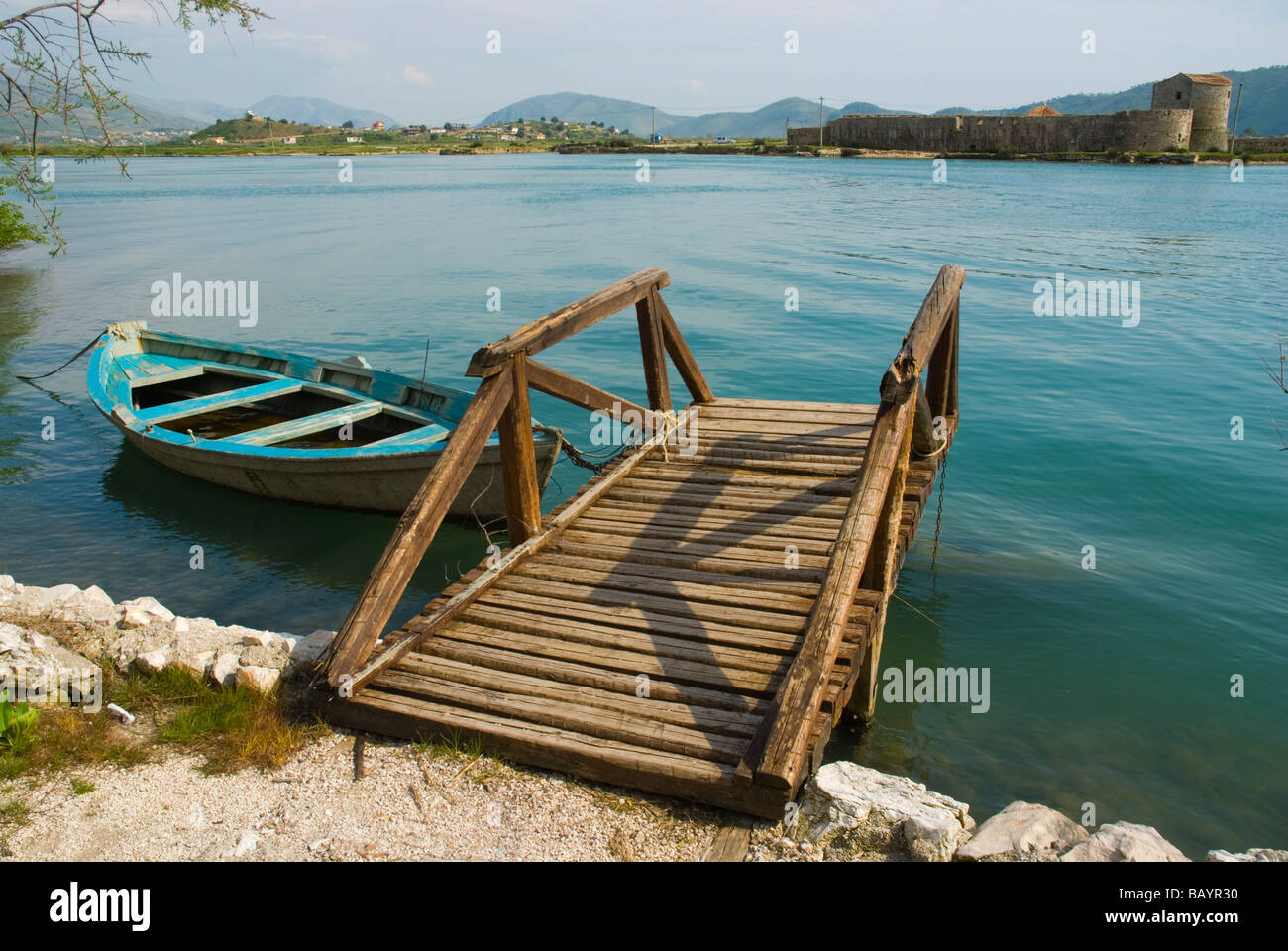 Boat and quay with Venetian triangle castle in Butrint Albania Europe - Stock Image
