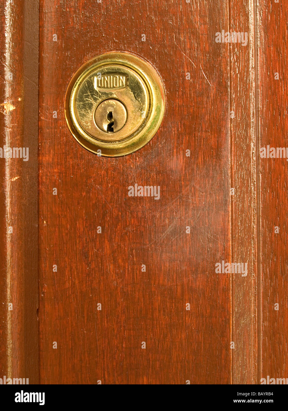 Union brand Yale type lock in a wooden door scratched and worn with