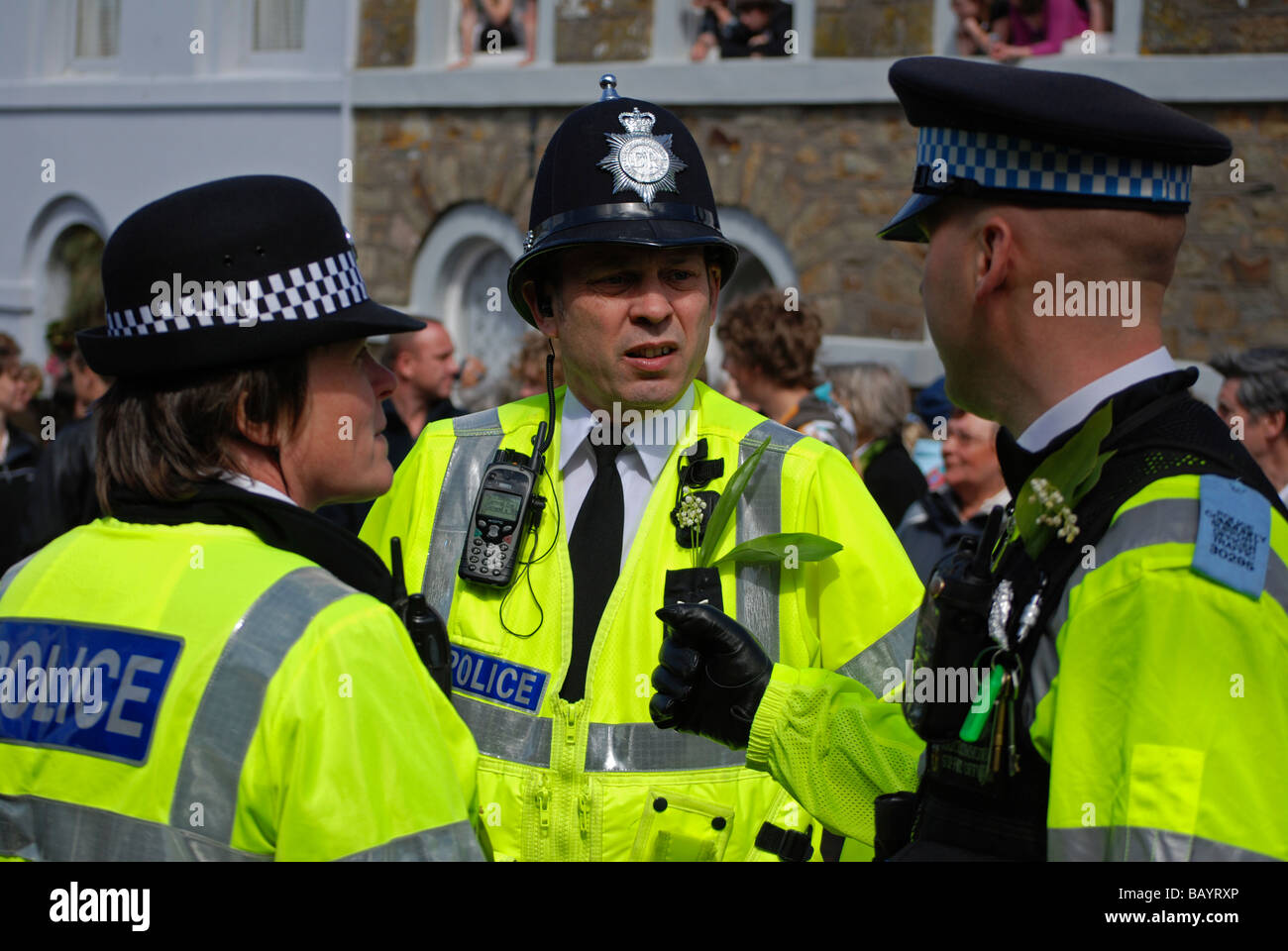 british police on crowd control duty at the helston flora day,helston,cornwall,uk - Stock Image