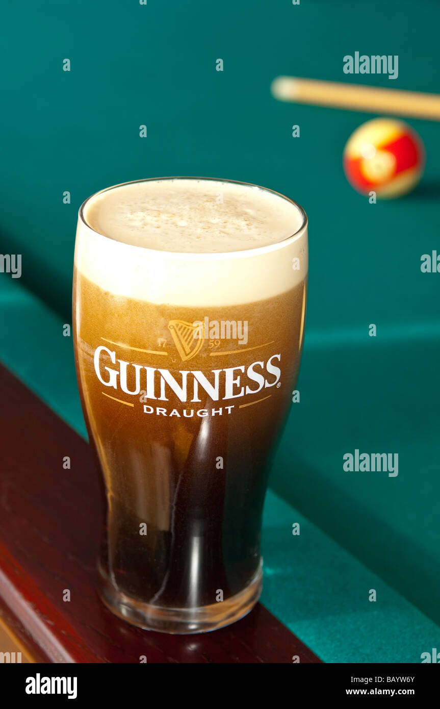 A Pint Of Guinness In A Glass At Pool Table Stock Photo - Guinness pool table