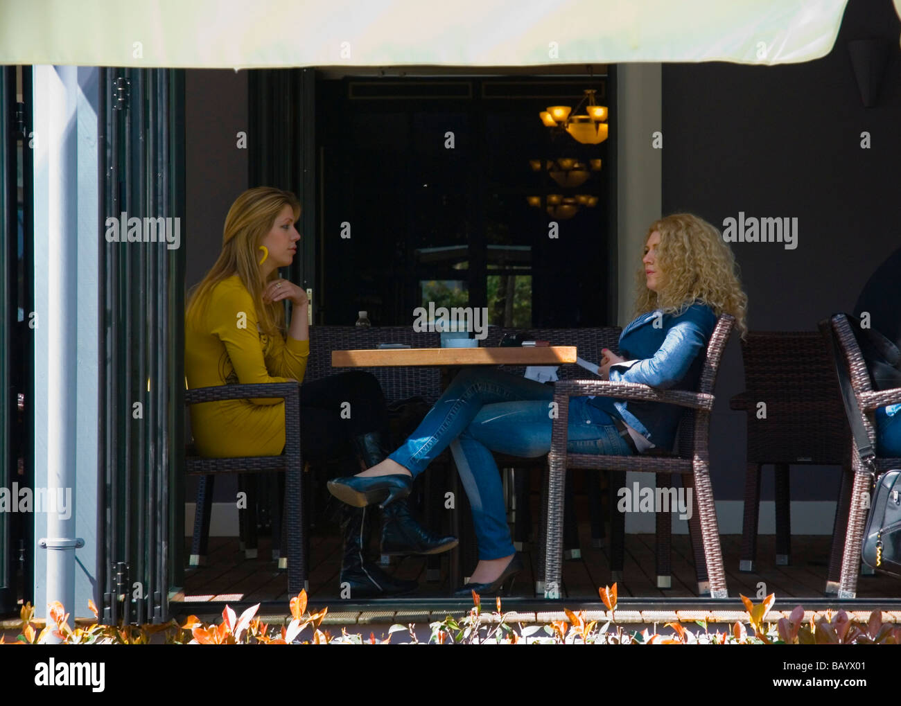 Women in a cafe in fashionable Blloku district of Tirana Albania Europe - Stock Image
