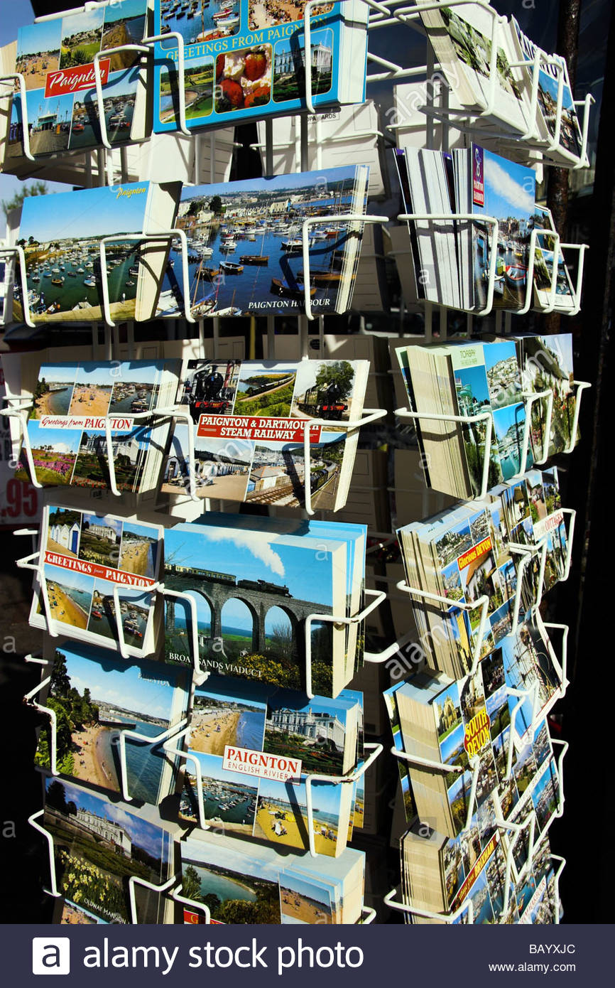 A rack of holiday postcards in Paignton, south Devon, England, UK. - Stock Image