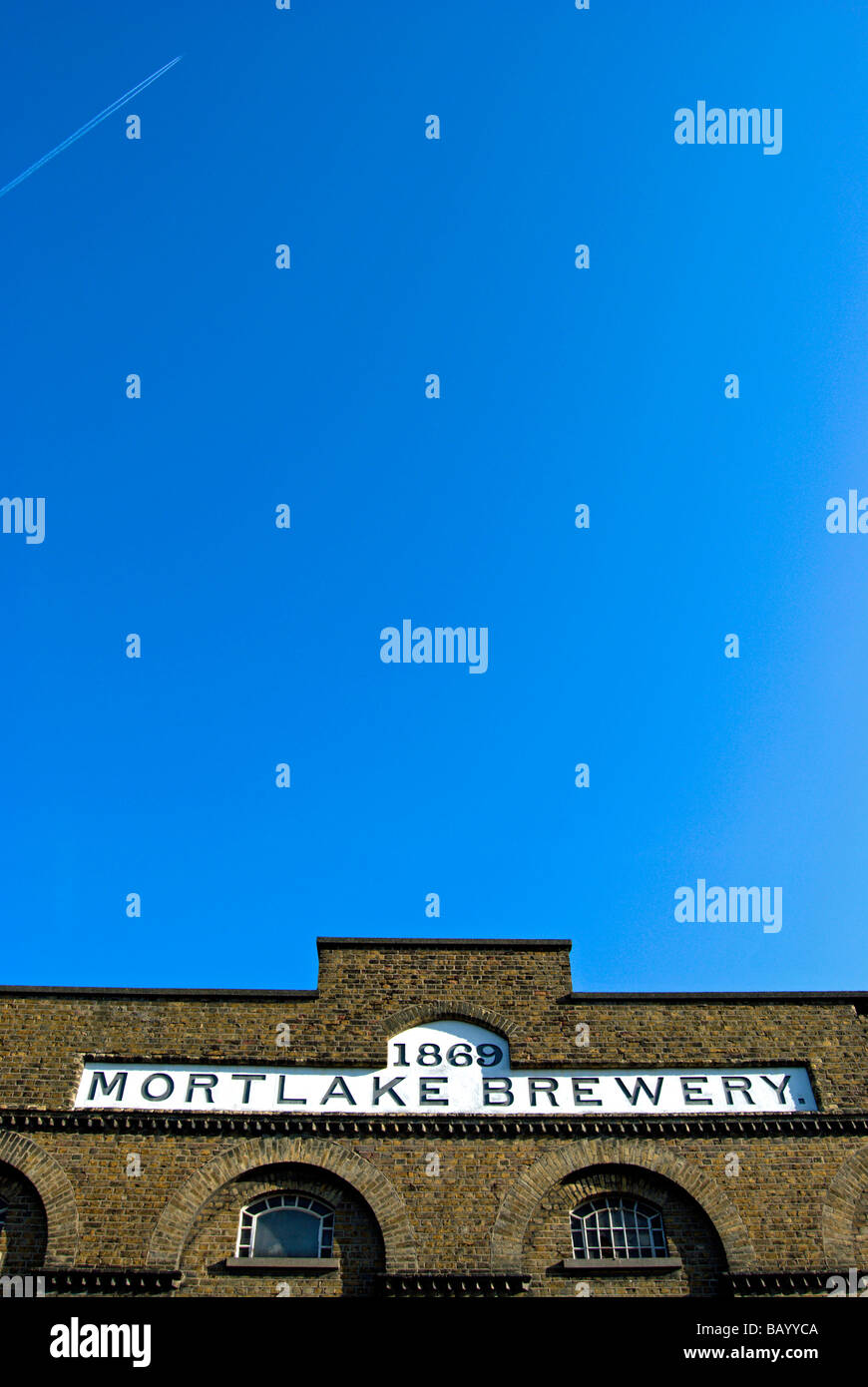 the name mortlake brewery and the date 1869 on a brick building in mortlake, southwest london, england - Stock Image
