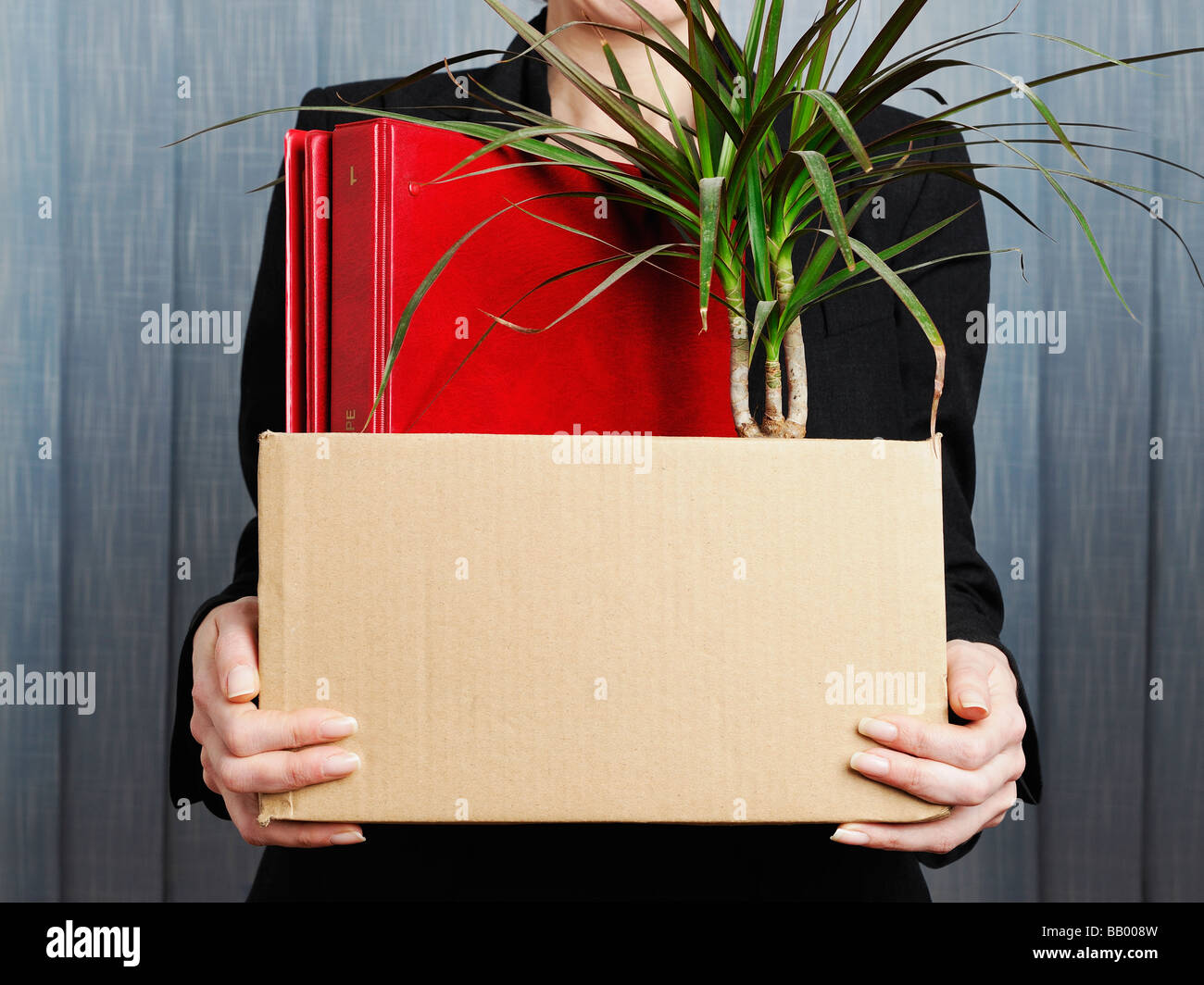 Businesswoman Clearing Her Office - Stock Image