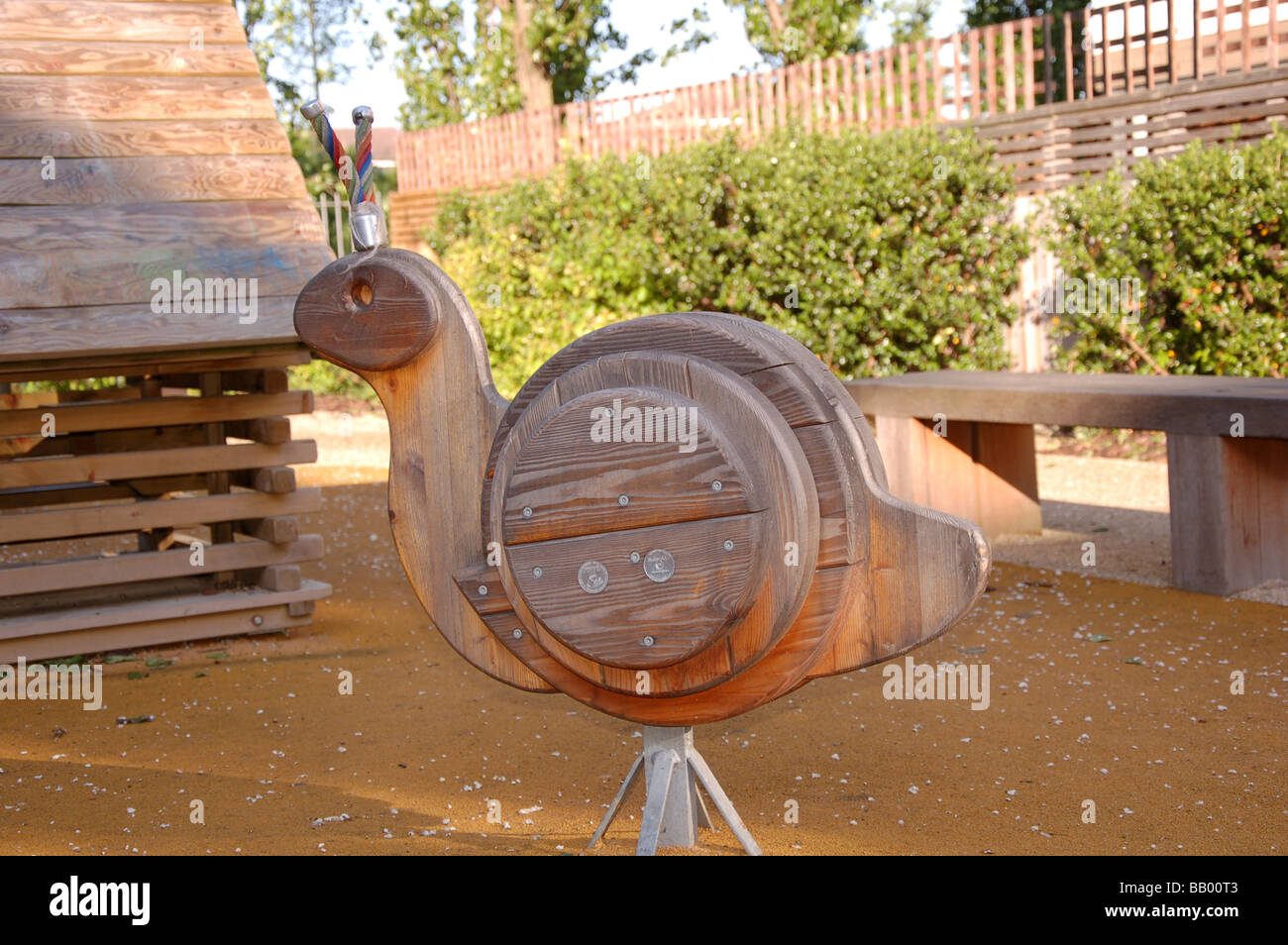 A wooden riding toy in a local children's community play ground at Colindale, London, England, Uk Stock Photo