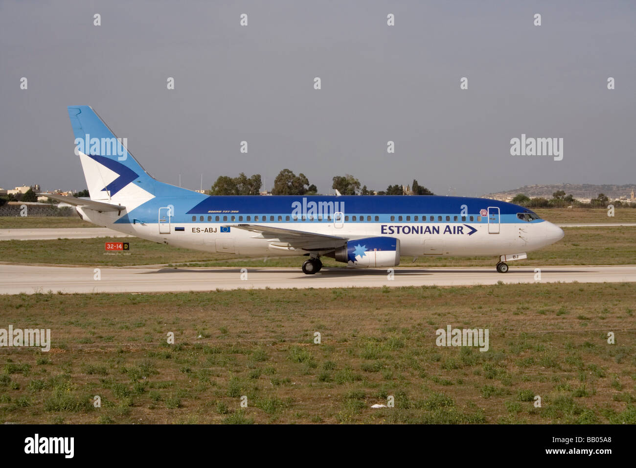 Estonian Air Boeing 737-300 passenger jet aeroplane taxiing on arrival in Malta. Commercial aviation in the EU. - Stock Image