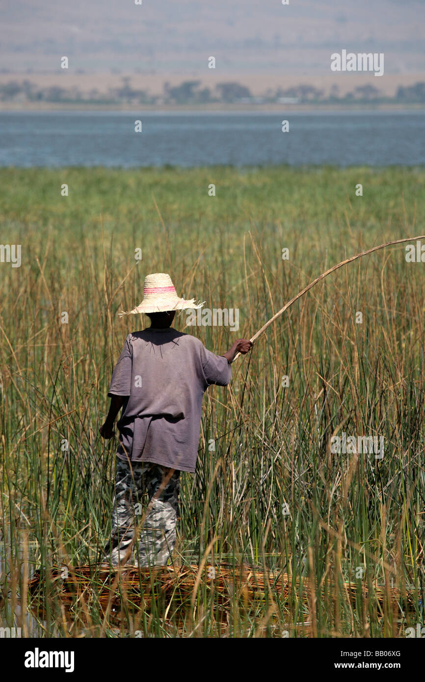 Man fishing from a reed boat in Lake Awasa Ethiopia - Stock Image