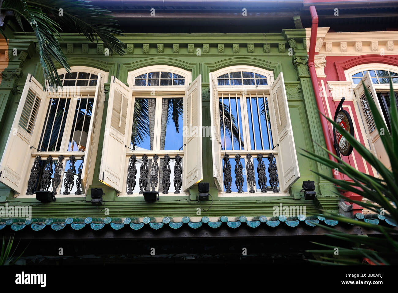 shuttered windows on restored houses in historic Emerald Hill, Singapore - Stock Image