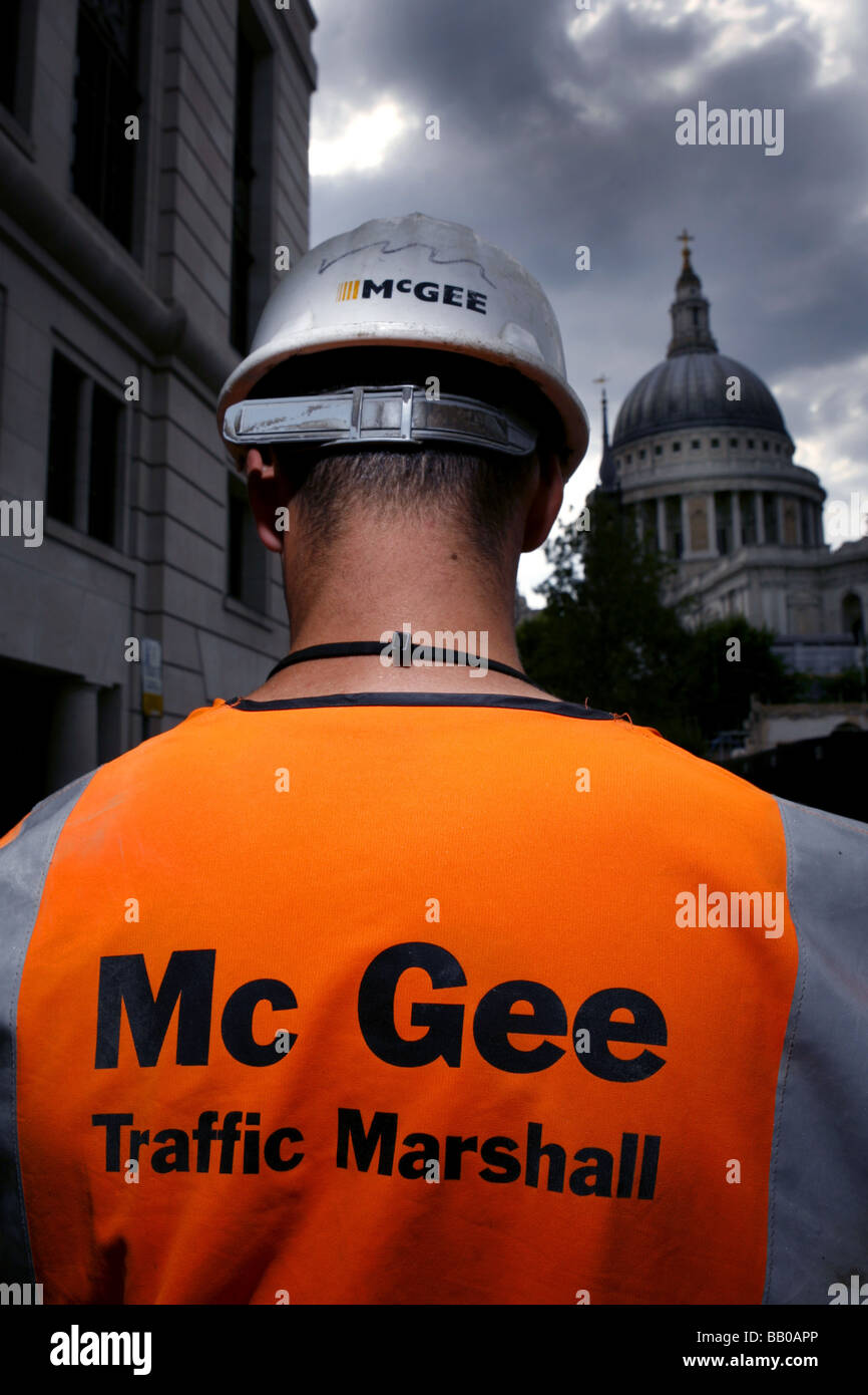 Mc Gee Builders work in the City with a view of St Pauls Cathederal - Stock Image