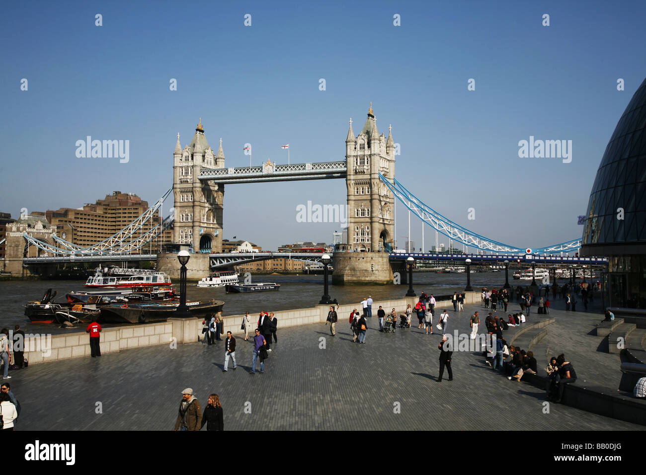 A view of Tower Bridge with City Hall, the Greater London Authority Building, on the right - Stock Image