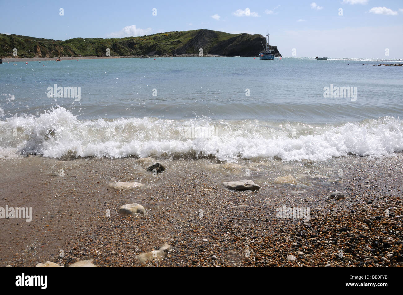Breaking wave  at Lulworth Cove - Stock Image