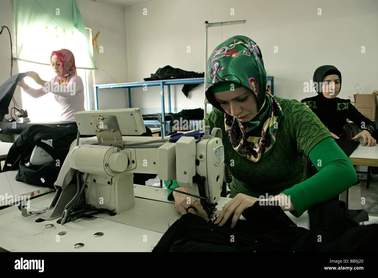 Textiles workers at a sweatshop in Pendik, Istanbul, Turkey - Stock Image