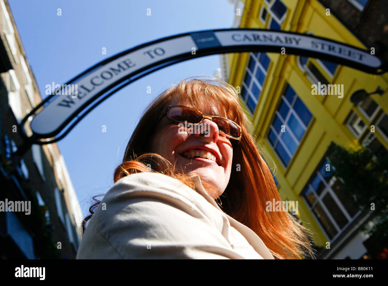 Woman with red hair on Carnaby Street London. - Stock Image