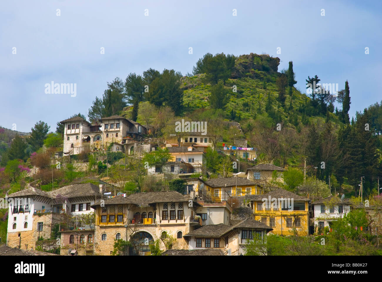 Houses on side of a hill Gjirokastra birthplace of former dictator Enver Hoxha in Southern Albania Europe - Stock Image