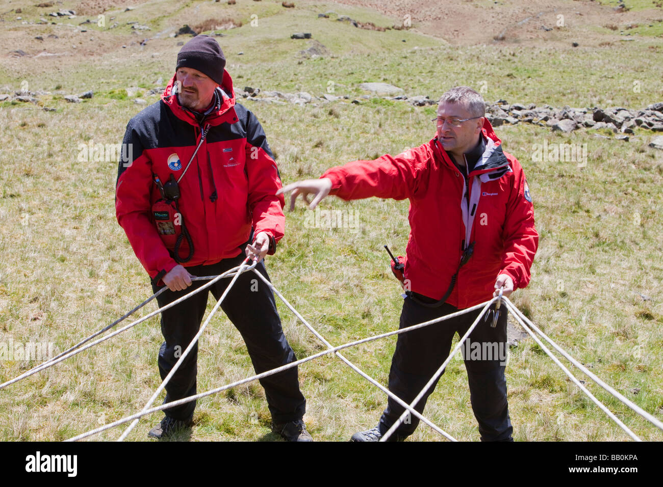 A mountain rescue team set up a belay for descnding Red Screes Lake District UK - Stock Image