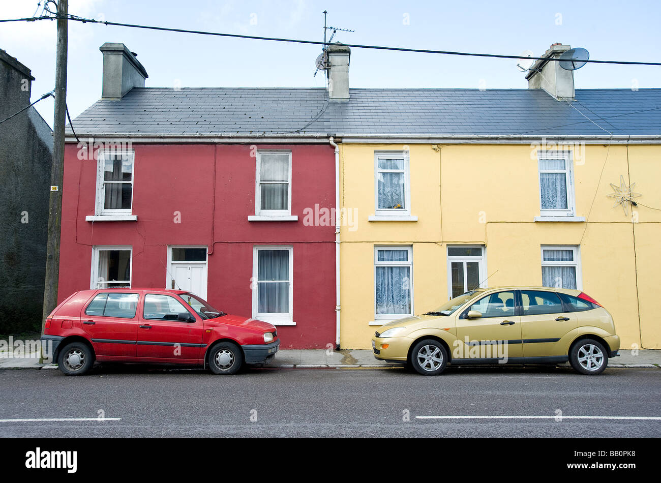 These neighbors may love their favorite color a little too much Ireland - Stock Image