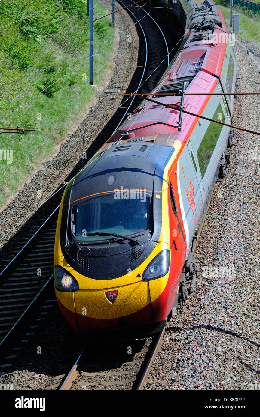 British Rail Class 390 Pendolino, electric multiple unit, at speed. West Coast main line, Lambrigg, Cumbria, England, - Stock Image