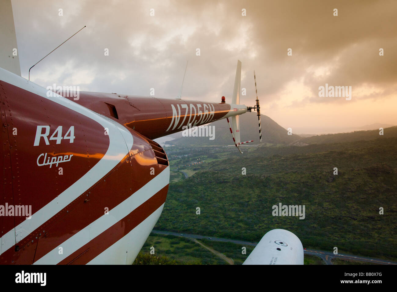 Back half of helicopter at sunset overlooking landscape - Stock Image