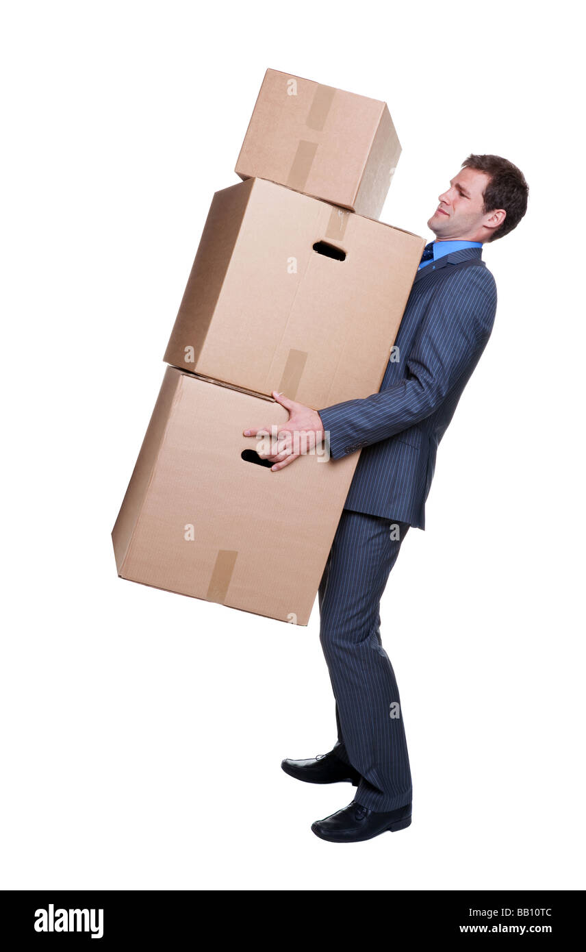 Businessman struggling to carry some heavy boxes isoalted on white background - Stock Image