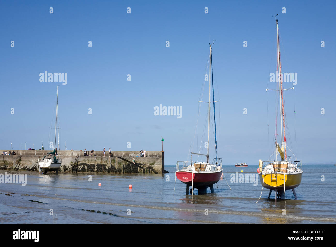 Sailing boats on the beach in New Quay , Cei Newydd at low tide. - Stock Image