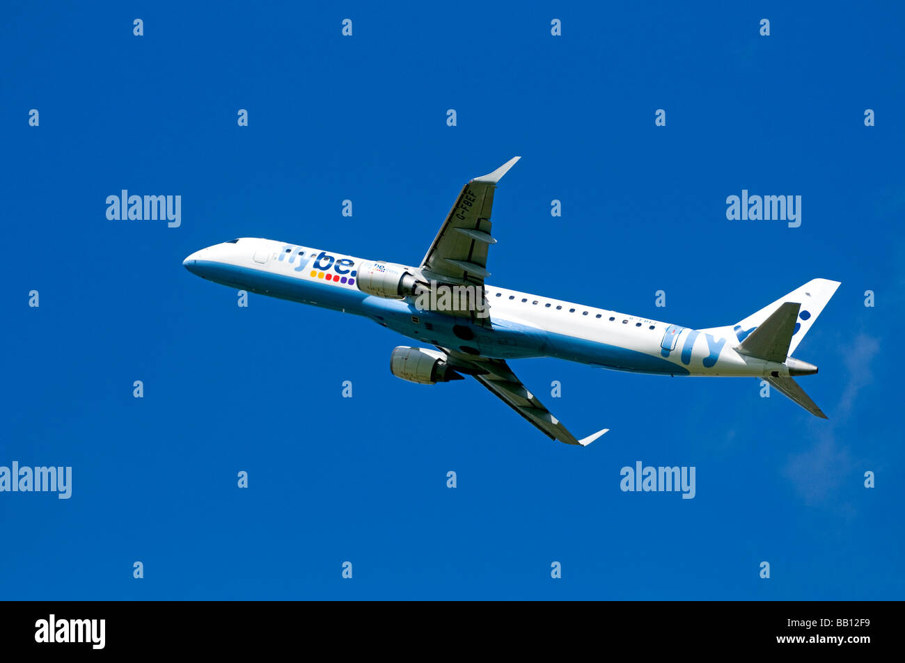 Twin engined Embraer ERJ-190-2000-195LR Flybe Civil Airliner departing Inverness  Airport Highland Scotland - Stock Image