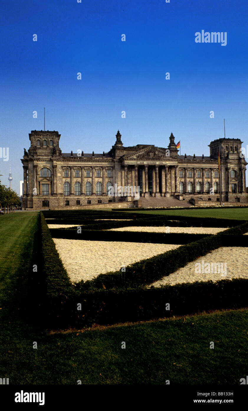 Life in Germany in Berlin the famous Hitler Reichstag Building with German flag in Berlin Germany - Stock Image